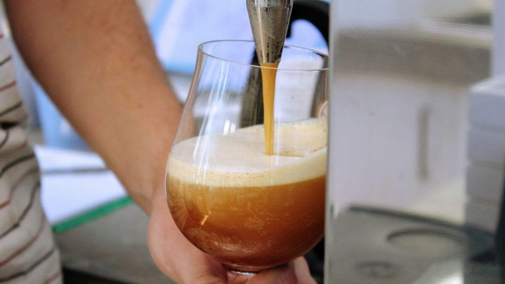 Nitro coffee bubbles close up