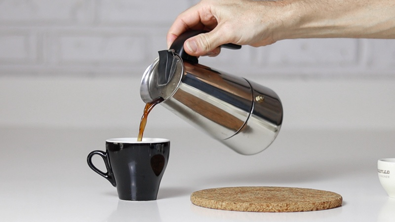 pouring coffee at home into cup