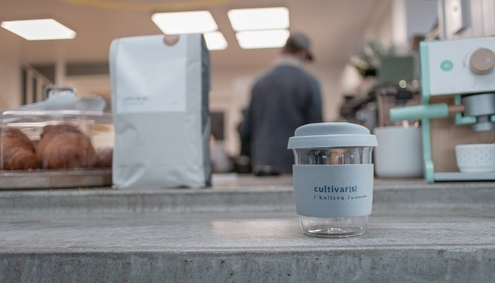 reusable coffee cup on counter at cafe