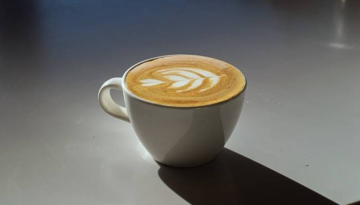 flat white coffee on bench