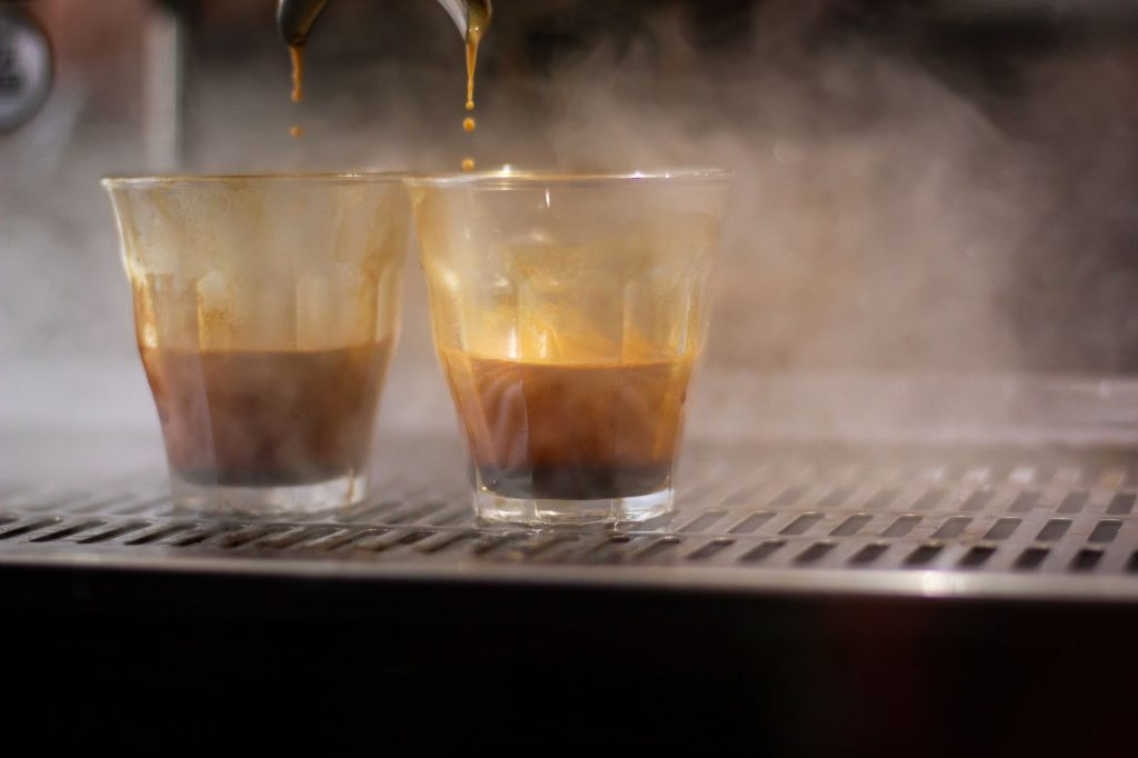 Espressos being poured